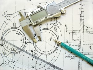 engineer tools on a technical drawing. caliper ruler and mechanical pencil.